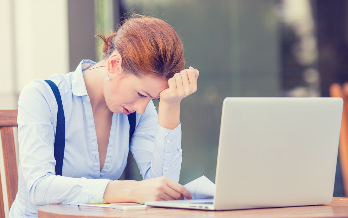 stressed displeased business woman sitting in front of computer