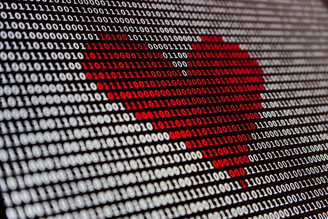 rotes Herz in Programmierzeichen
